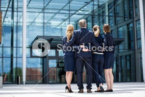 Businesspeople forming a huddle in office premises