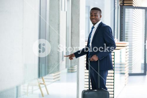 Businessman pressing the button for an elevator