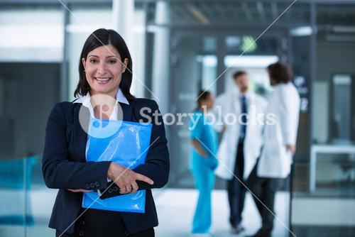 Confident businesswoman holding a file