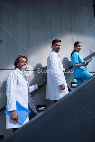 Doctors and nurse standing on staircase