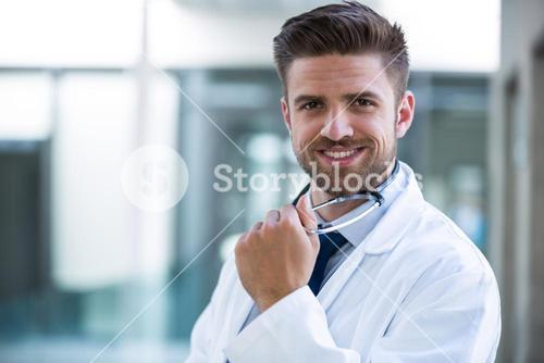 Confident doctor in hospital