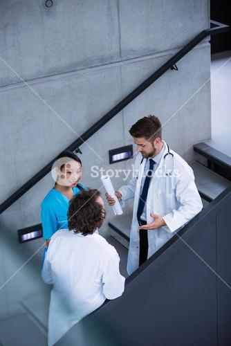 Doctors and nurse having a discussion on stairs