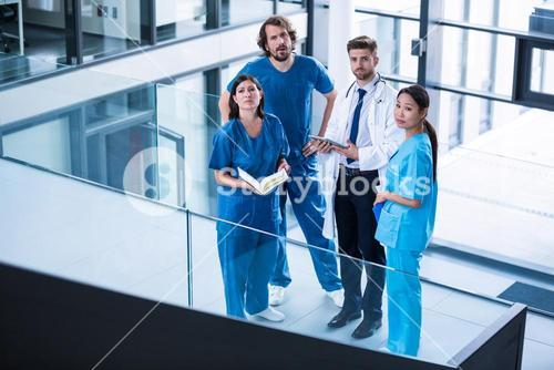 Surgeons, doctor and nurse standing in hospital