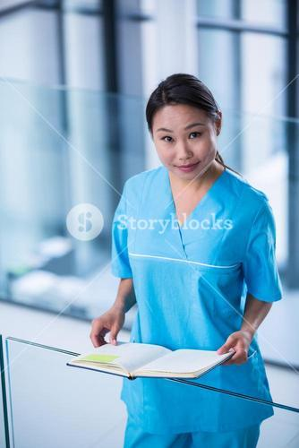 Nurse holding a diary in hospital