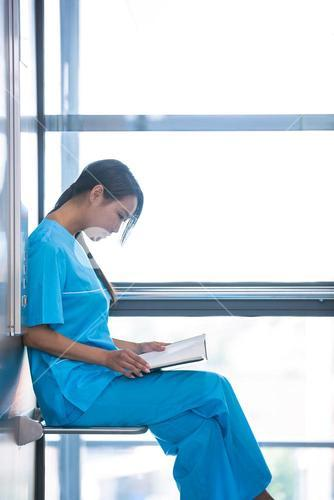 Nurse looking at her diary