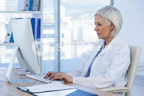 Female doctor working on computer