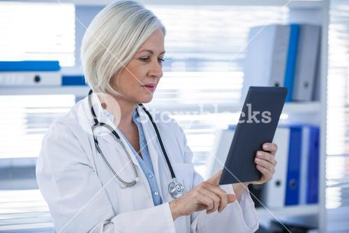 Doctor using digital tablet