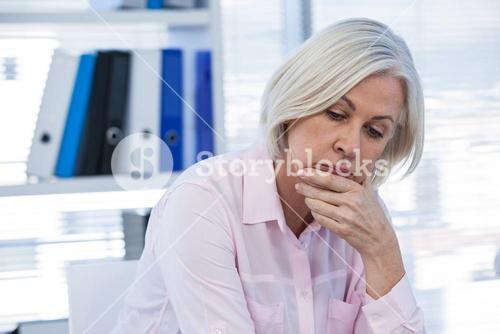 Upset patient sitting at medical clinic