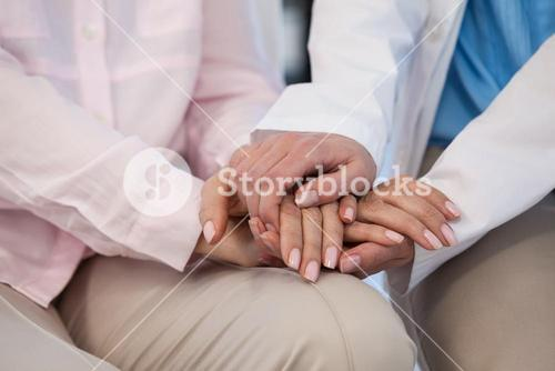 Close-up of female doctor consoling a patient