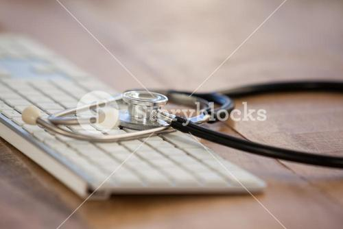 Close-up of keyboard with stethoscope