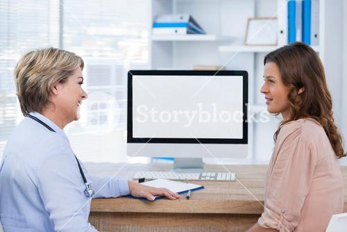 Smiling patient consulting a doctor