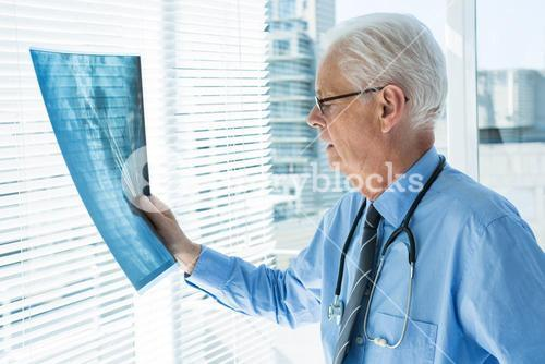 Doctor analyzing x-ray report