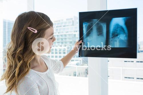 Girl looking at x-ray report