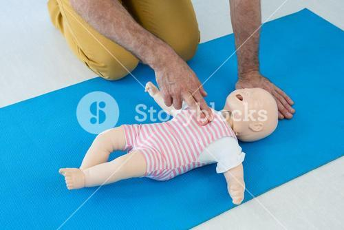 Paramedic practising resuscitation on dummy