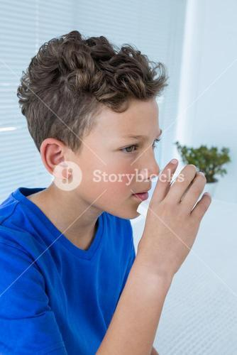 Boy using asthma pump