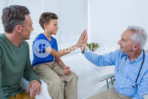 Doctor giving high five to a patient