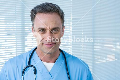 Portrait of smiling surgeon