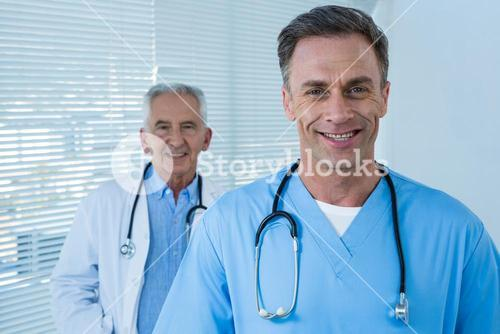 Portrait of smiling doctor and surgeon
