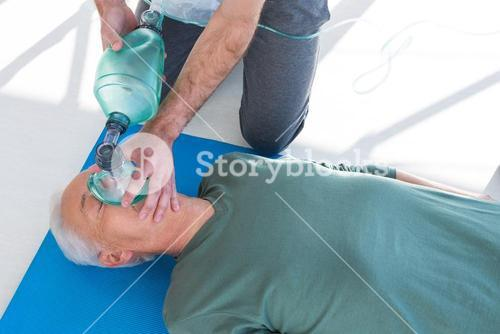 Paramedic performing resuscitation on patient