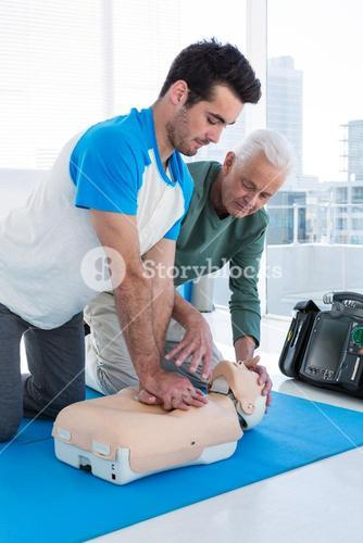 Paramedic training cardiopulmonary resuscitation to man