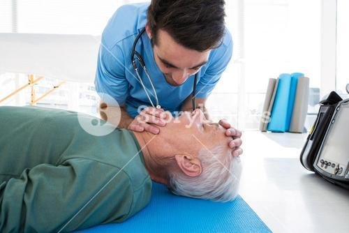 Doctor performing resuscitation on patient