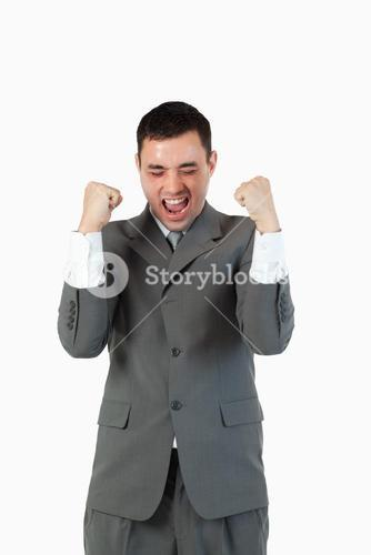 Portrait of a businessman with the fists up