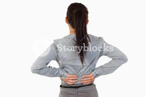 Painful back of a businesswoman