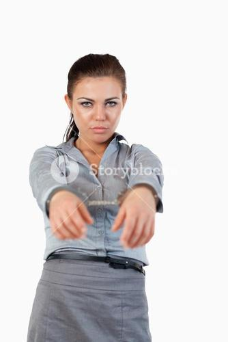 Portrait of a young businesswoman with handcuffs