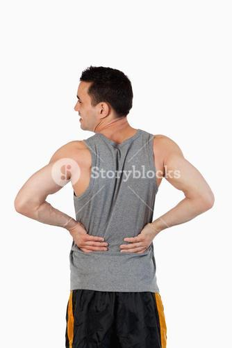 Portrait of a man having a back pain