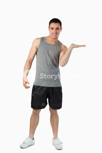 Male in sports cloths presenting