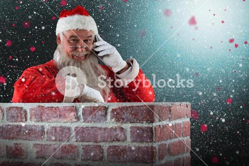 Composite image of santa claus standing beside chimney and talking on mobile phone