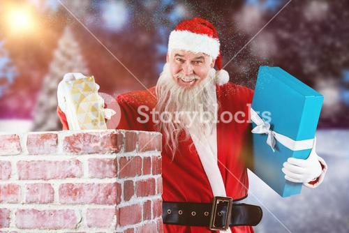 Composite image of portrait of santa claus placing gift boxes into chimney