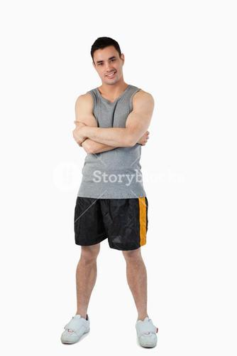 Sporty young male with arms folded