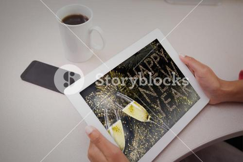 Composite image of woman using tablet pc