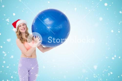 Composite image of smiling blonde woman holding exercise ball