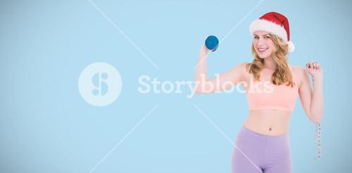 Composite image of smiling fit blonde holding dumbbell and measuring tape