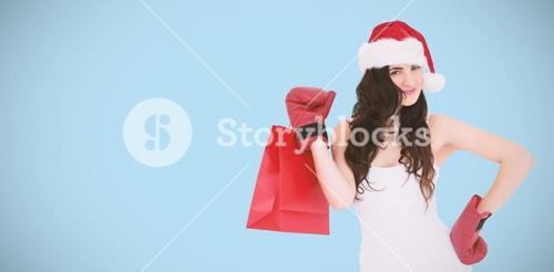 Composite image of beauty brunette in boxing gloves with shopping bag