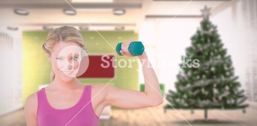 Composite image of happy blonde lifting dumbbell and flexing