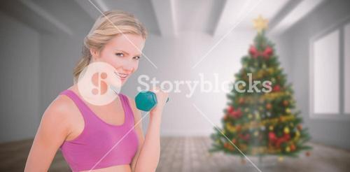 Composite image of happy fit woman