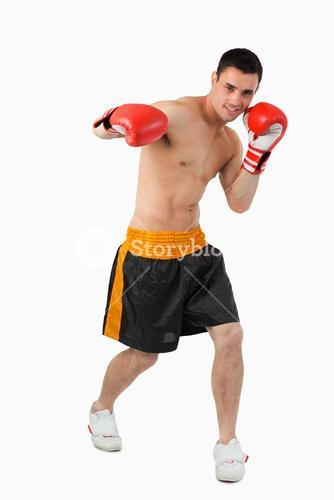 Young boxer performing a right hook