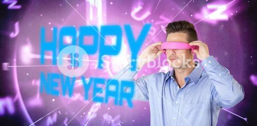 Composite image of man using pink virtual video glasses
