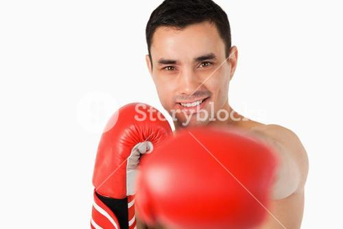 Smiling boxer striking with left fist