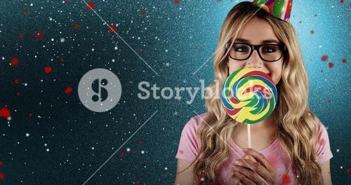 Composite image of a beautiful hipster holding a giant lollipop