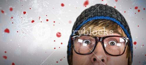 Composite image of close up of half face of hipster man
