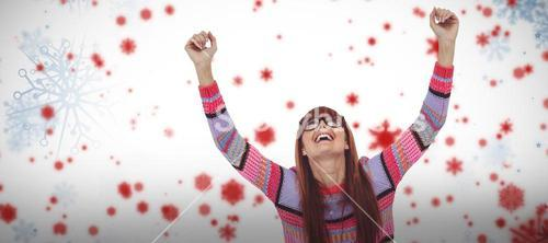 Composite image of smiling hipster woman using laptop while putting hands up