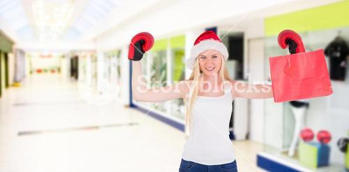 Composite image of festive blonde cheering with boxing gloves