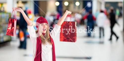 Composite image of pretty blonde carrying shopping bags