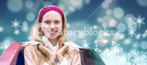 Composite image of smiling woman with shopping bags