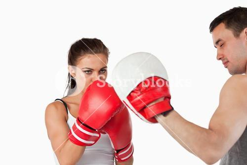Female boxer focused on her target