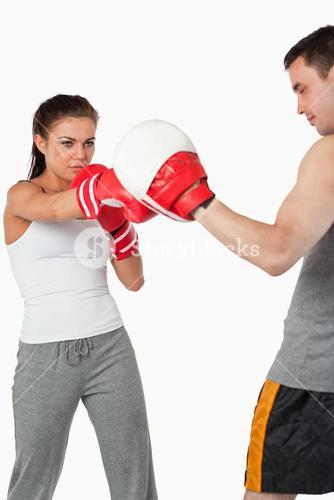 Young female boxer focused on her target
